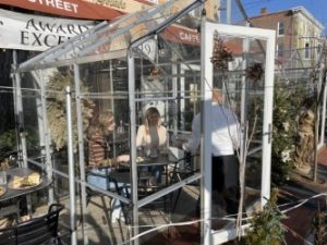 Caffe Gelato installed outdoor greehouse structures for outdoor dining.